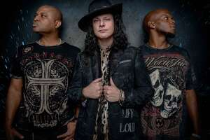 GOMES & CO.: Anthony Gomes, center, will bring his high-energy blues rock show to Bridge Street Live in Collinsville, a section of Canton (between Torrington and West Hartford), on Friday, Nov. 17 at 8 p.m. He'll be joined by bassist Carlton Armstrong and drummer Freddy Spencer Jr.