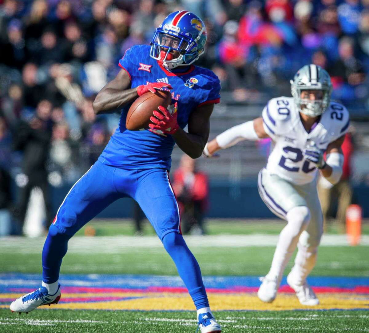 Kansas wide receiver Steven Sims Jr. (11) catches a pass in front of Kansas State defensive back Denzel Goolsby (20) in the first half at Memorial Stadium in Lawrence, Kan., on Saturday, Oct. 28, 2017. K-State won, 30-20. (Shane Keyser/Kansas City Star/TNS)