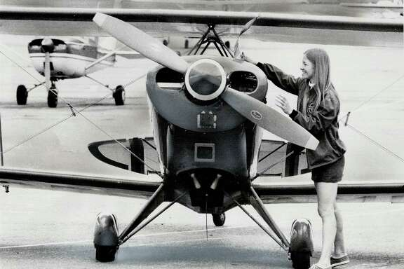 In this file photo from the 1970s, Debbie Gary does a pre-flight check of her stunt biplane.