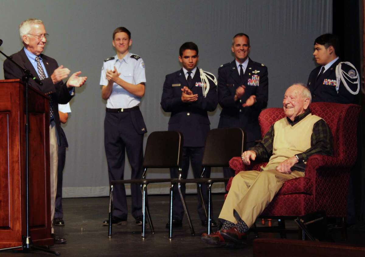 World War II veteran Donald V. Blair is applauded by his friendTom Evans, former Army Infantry Major, and the Kingwood Park High School JROTC during a ceremony held in his honor on Friday, Nov. 10.