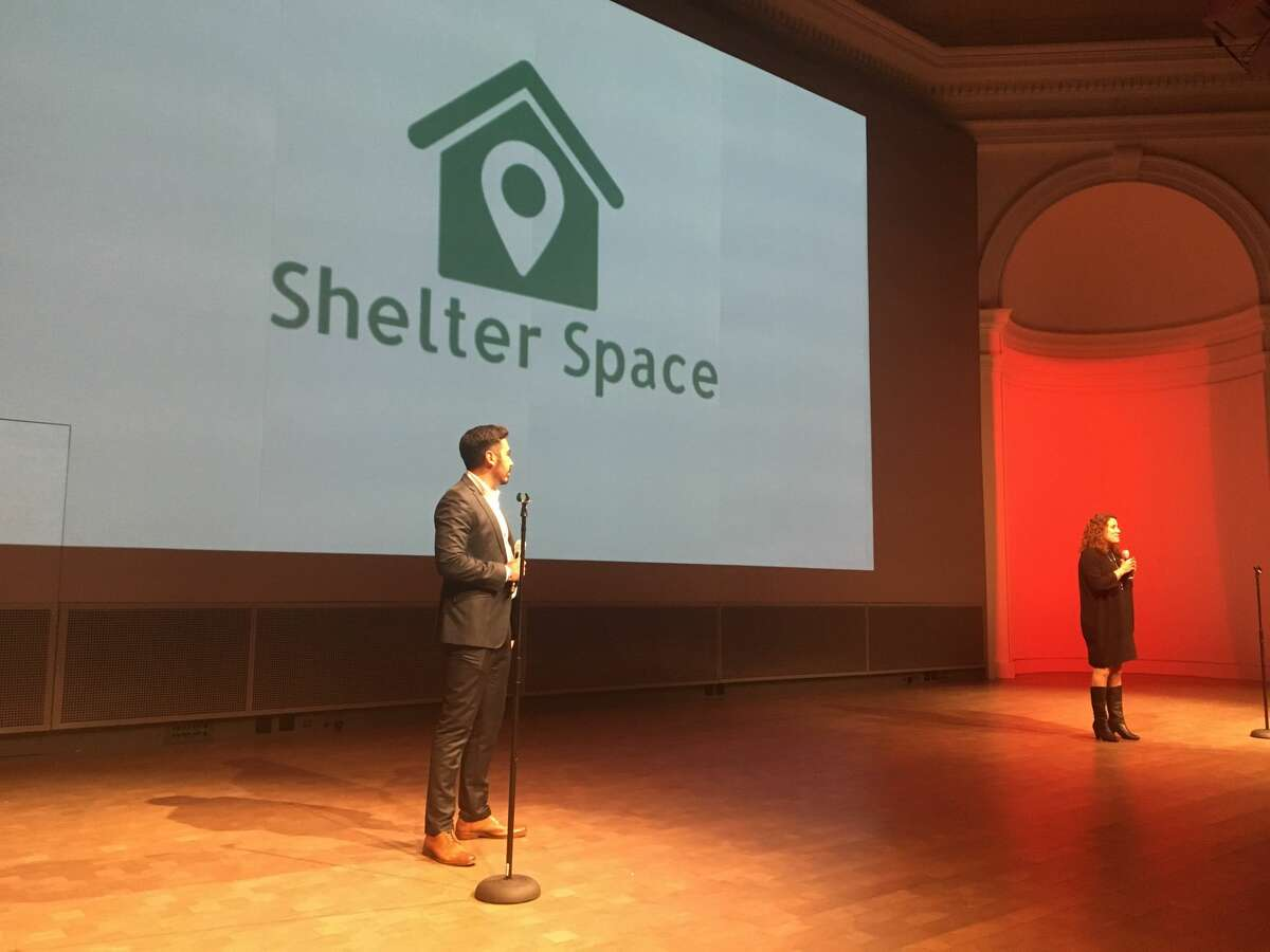 Shelter Space co-founders John DeLeon and Julia Kheff present their app Shelter Space at AngelHack's Global Demo at the War Memorial and Performing Arts Center in San Francisco on Nov. 2.