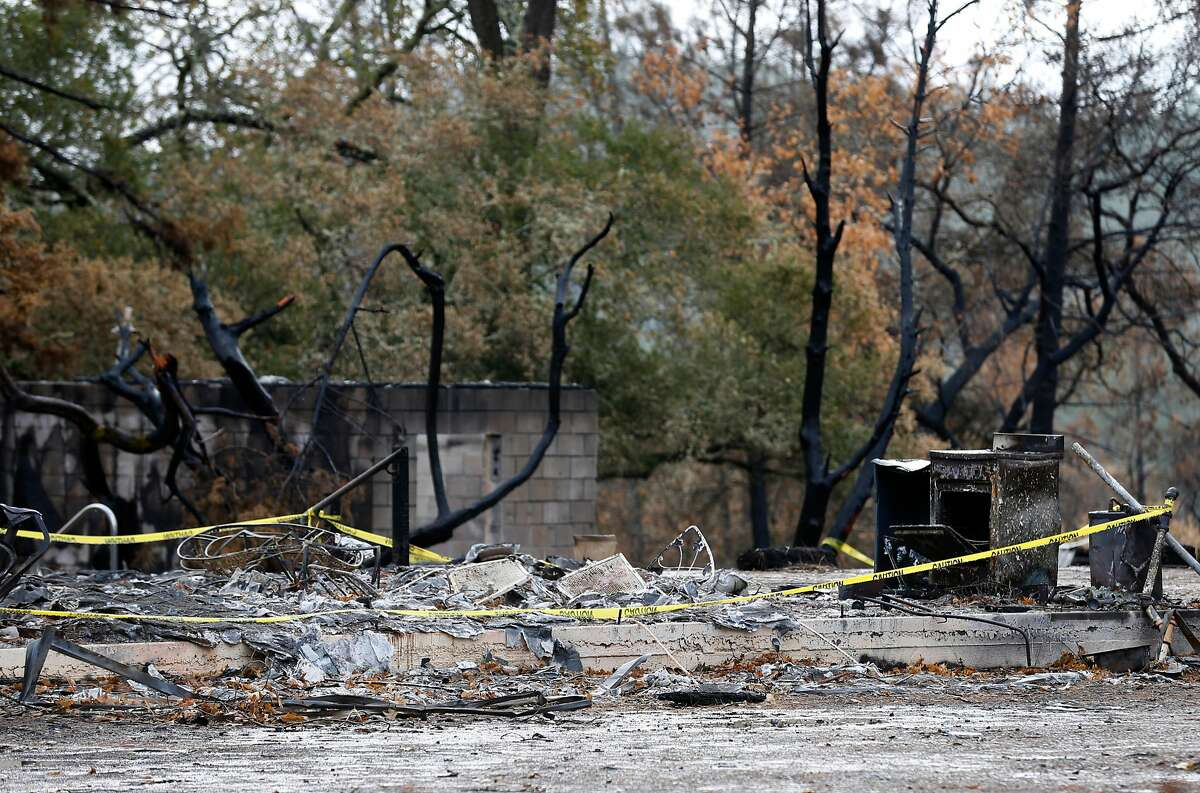 Yellow tape surrounds a burned structure on Bennett Lane in Calistoga, Calif. on Friday, Nov. 10, 2017 on the property where investigators believe the Tubbs Fire started. PG&E filed legal papers suggesting that third party electrical equipment, not theirs, may have been the cause of last month's deadly Tubbs Fire.