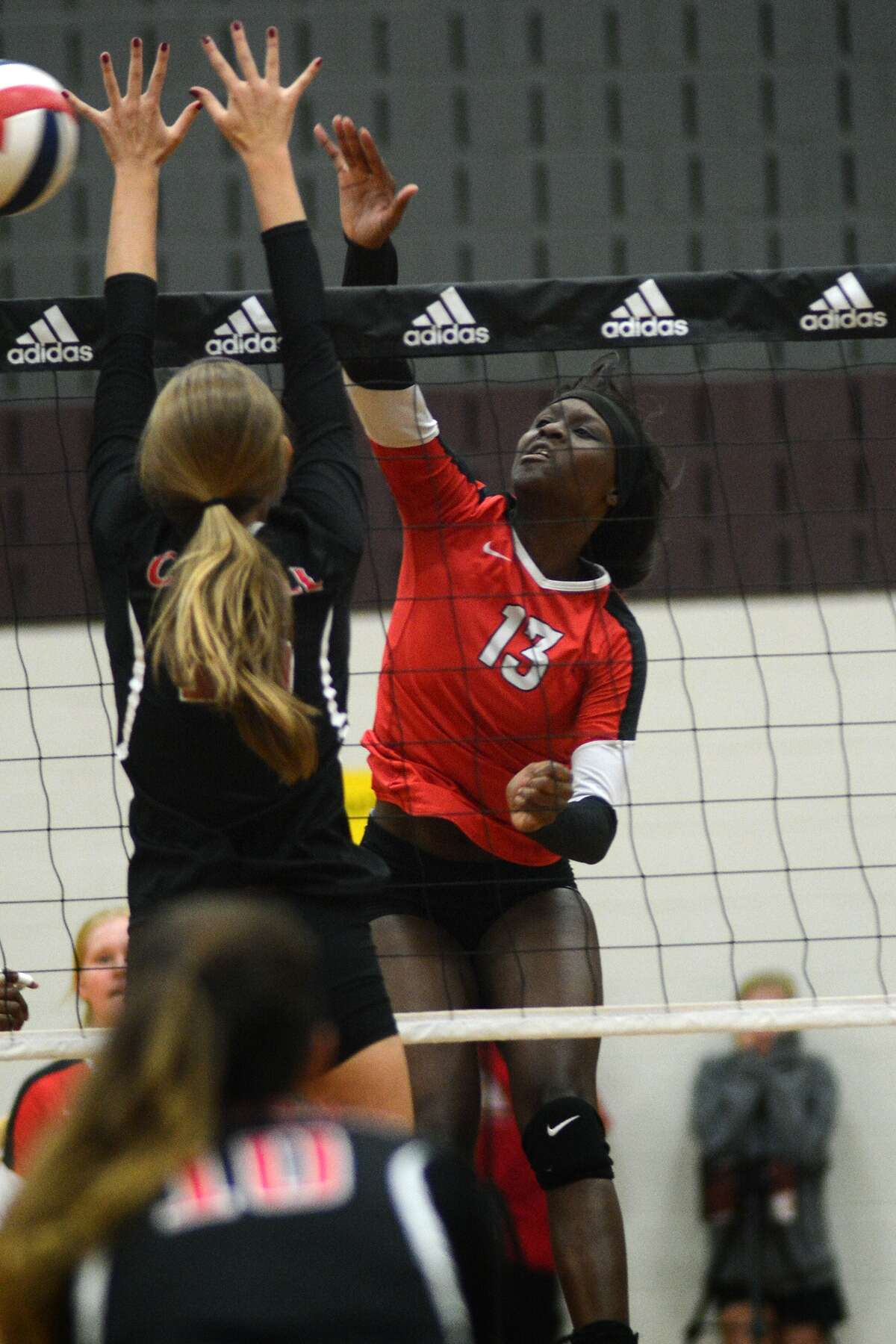Bellaire junior outside hitter Maya Evans (13) works for a kill against a Coppell defender during Gold Bracket play at the 2015 Adidas Texas Volleyball Invitational at Pearland Dawson High School on Friday, August 14, 2015. (Photo by Jerry Baker/Freelance)