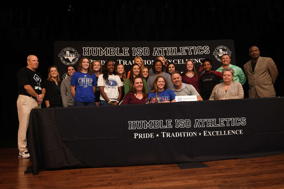 Madison Forrester, front row center, who plays softball for Kingwood Park High School, signs with Hill College during the Humble ISD Signing Day Ceremony at Charles Bender Performing Arts Center in Humble on Nov. 8, 2017. (Photo by Jerry Baker/Freelance)