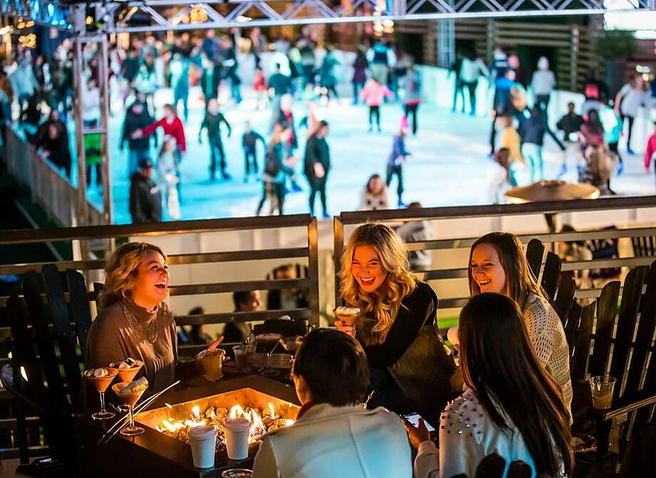 The Cosmopolitan in Las Vegas turns its rooftop pool into a holiday ice rink, with seasonal food and drink served at the fire pits nearby. Photo: Cosmopolitan Las Vegas