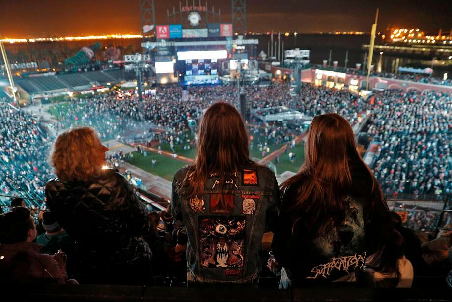 L-R, Emily Reynolds, her son, Tyler Gladden, 15, and Aerin Johnson, 17, wait for Metallica to come on stage during the Band Together Bay Area benefit concert at AT&T Park in San Francisco Calif., Thursday, November 9, 2017. The boys are in a band called Scythe, and the families had to evacuate the fire area that was threatened during the fire storm. The concert was a benefit for the Tipping Point Emergency Relief Fund for North Bay fire relief. Photo: Carlos Avila Gonzalez, The Chronicle