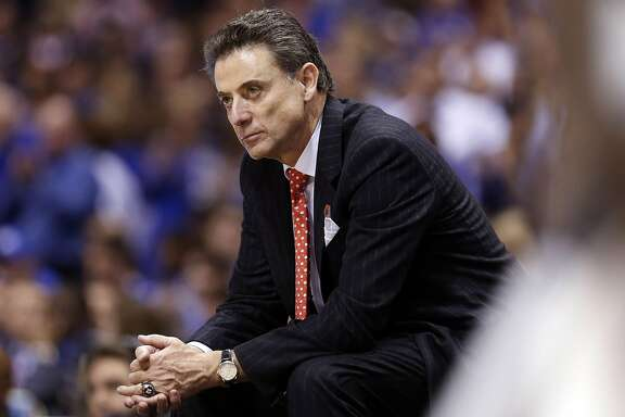 Louisville head coach Rick Pitino late in the second half of a 74-69 loss to Kentucky in the NCAA Tournament's Midwest Region semifinal at Lucas Oil Stadium in Indianapolis on March 28, 2014. (Charles Bertram/Lexington Herald-Leader/TNS)
