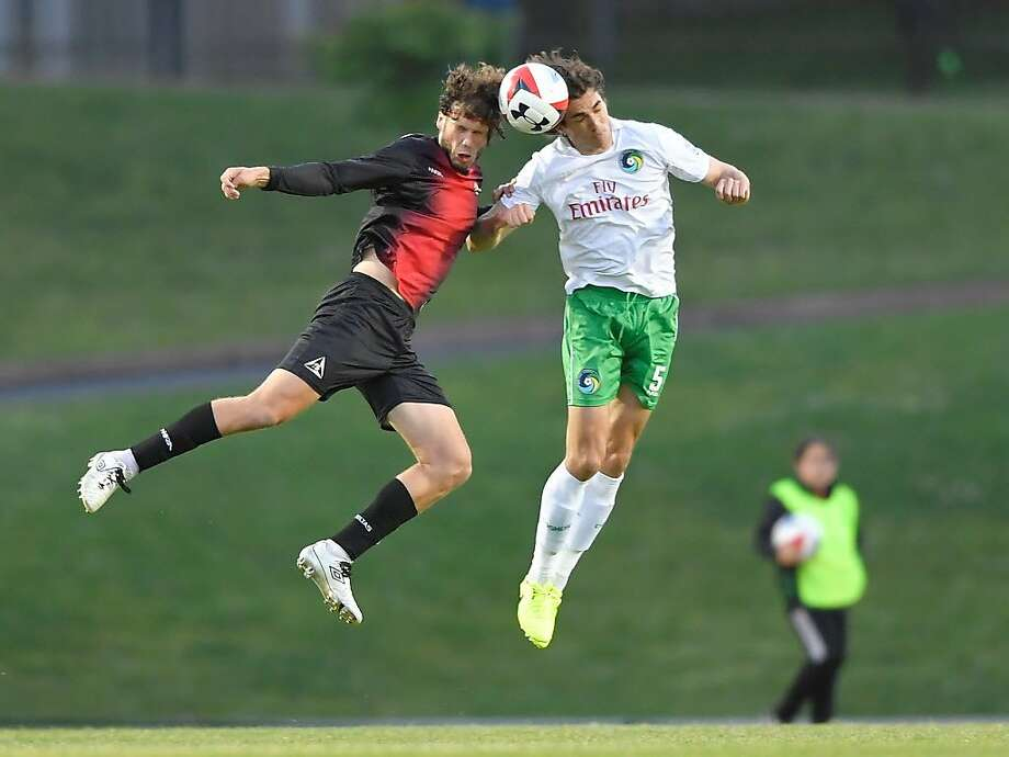 San Francisco Deltas forward Tommy Heinemann and the New York Cosmos Dejan Jakovica fight for a header at Kezar Stadium in San Francisco, CA on April 29, 2017. Photo: Robert Edwards, Robert Edwards-Robtography