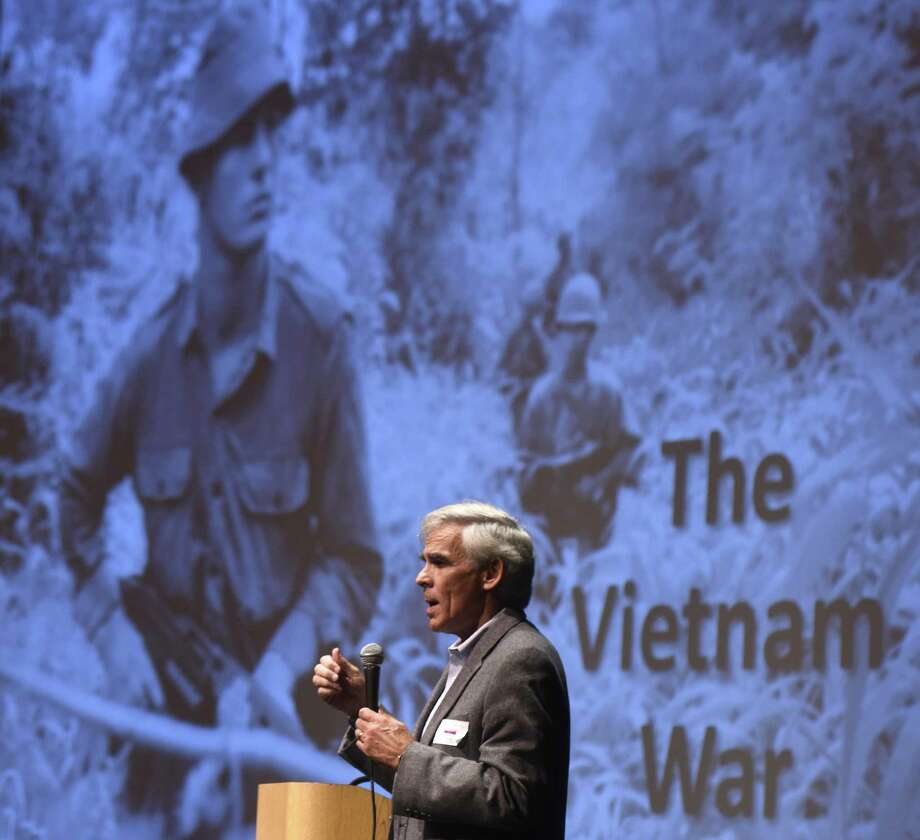 Vietnam veteran Bruce Winningham, of Old Greenwich, speaks during a Veterans Day assembly at Greenwich High School in Greenwich, Conn. Thursday, Nov. 9, 2017. Winningham and two other veterans gave a brief overview of the Vietnam War and answered students' questions about the war and their specific roles and duties. Ed Vick was a U.S. Navy patrol boat group commander in Vietnam from 1968 to 1969, Bob Moore was a U.S. Army infantry rifle platoon leader in Vietnam from 1970 to 1971, and Bruce Winningham was U.S. Navy squadron navigator in Vietnam from 1970 to 1972. Photo: Tyler Sizemore / Hearst Connecticut Media / Greenwich Time