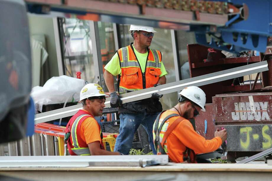 Construction crews work on building a new Marriott Residence Inn on Terry Avenue in downtown Seattle, Tuesday, Aug. 29, 2017. Through a survey, contractors across the country have reported a worker shortage. Photo: GENNA MARTIN /GENNA MARTIN, SEATTLEPI.COM / SEATTLEPI.COM