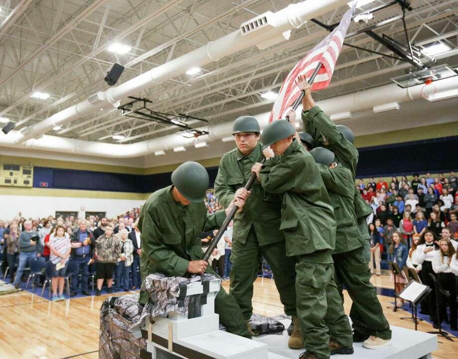 Oak Hills Junior High students reenact the raising of the flag at Iwo Jima during the Veterans Day Celebration on Friday, Nov. 10, 2017, in Montgomery. Photo: Michael Minasi, Staff Photographer / © 2017 Houston Chronicle