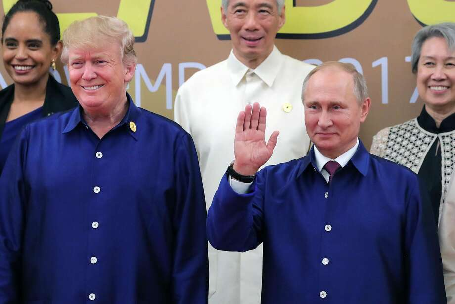 US President Donald Trump (L) and Russia's President Vladimir Putin (R) pose for a group photo ahead of the Asia-Pacific Economic Cooperation (APEC) Summit leaders gala dinner in the central Vietnamese city of Danang on November 10, 2017. Photo: MIKHAIL KLIMENTYEV, AFP/Getty Images