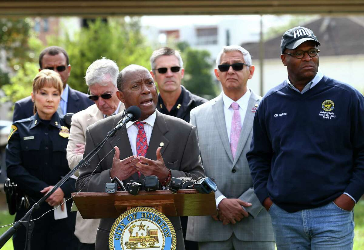 Mayor Sylvester Turner, center, speaks during a press conference addressing violence issues at the homeless encampment under the U.S. 59 Highway bridge Thursday, Nov. 9, 2017, in Houston. There's been a string of shootings and a stabbing in the past three months, including a homeless man who was shot and killed Tuesday night. ( Godofredo A. Vasquez / Houston Chronicle )