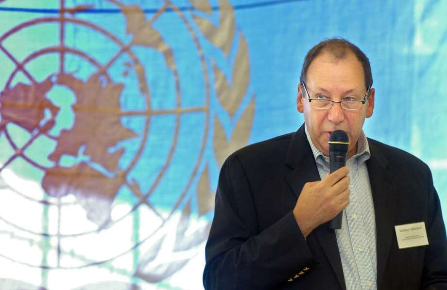 Guest speaker Michael Adlerstein, the assistant secretary general of the UN, addresses the audience Saturday June 26, 2010 at Saugatuck School for Westport's annual UN Day. Photo: Autumn Driscoll / Connecticut Post