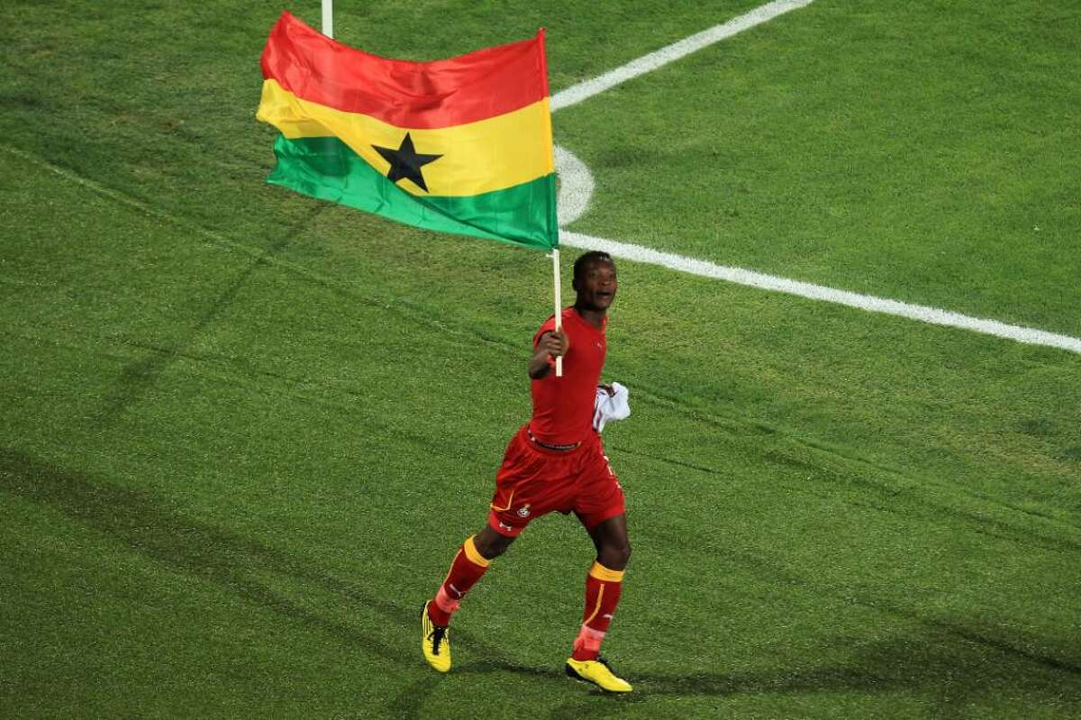 RUSTENBURG, SOUTH AFRICA - JUNE 26: John Pantsil of Ghana flies the national flag as he celebrates victory following the 2010 FIFA World Cup South Africa Round of Sixteen match between USA and Ghana at Royal Bafokeng Stadium on June 26, 2010 in Rustenburg, South Africa. (Photo by Martin Rose/Getty Images) *** Local Caption *** John Pantsil