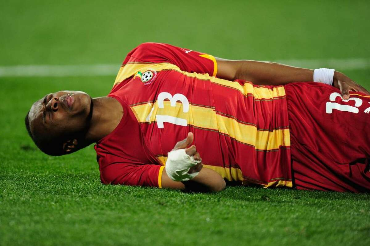 RUSTENBURG, SOUTH AFRICA - JUNE 26: Andre Ayew of Ghana holds his leg in pain during the 2010 FIFA World Cup South Africa Round of Sixteen match between USA and Ghana at Royal Bafokeng Stadium on June 26, 2010 in Rustenburg, South Africa. (Photo by Stuart Franklin/Getty Images) *** Local Caption *** Andre Ayew