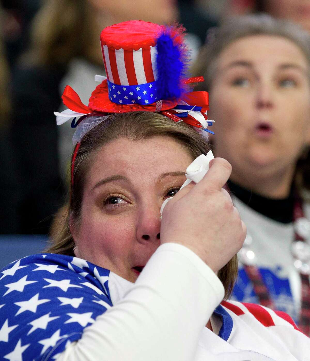 Robinn Graves wipes tears from her eyes after the Porter High School band competed in the UIL Marching Band State Championships at the Alamodome, Wednesday, Nov. 8, 2017, in San Antonio.