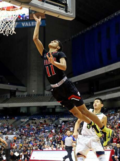 Thunderbird forward Daraun Clark sails in for a layup as Wagner plays the Cypress Falls Eagles in the state championship basketball game for class 6A boys at the Alamodome on March 11, 2017. Photo: Tom Reel /Express-News