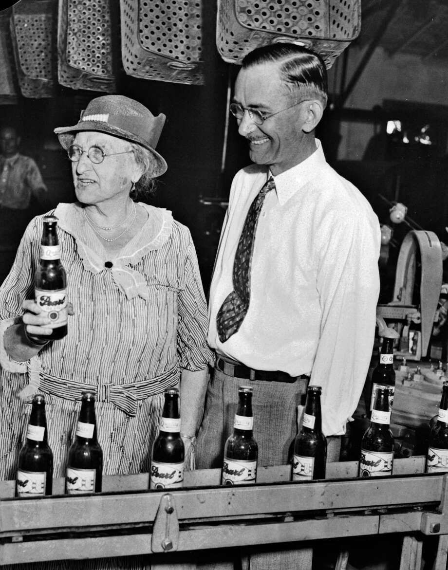 Emma Koehler, holds the first bottle of beer produced by Pearl Brewery after the repeal of Prohibition in 1933. Beside her is general manager B.B. McGimsey. For more than 25 years, Emma Koehler was one of the most powerful businesswomen in Texas. Photo: Courtesy UTSA Special Collections / handout