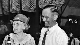 Emma Koehler, holds the first bottle of beer produced by Pearl Brewery after the repeal of Prohibition in 1933. Beside her is general manager B.B. McGimsey. For more than 25 years, Emma Koehler was one of the most powerful businesswomen in Texas.