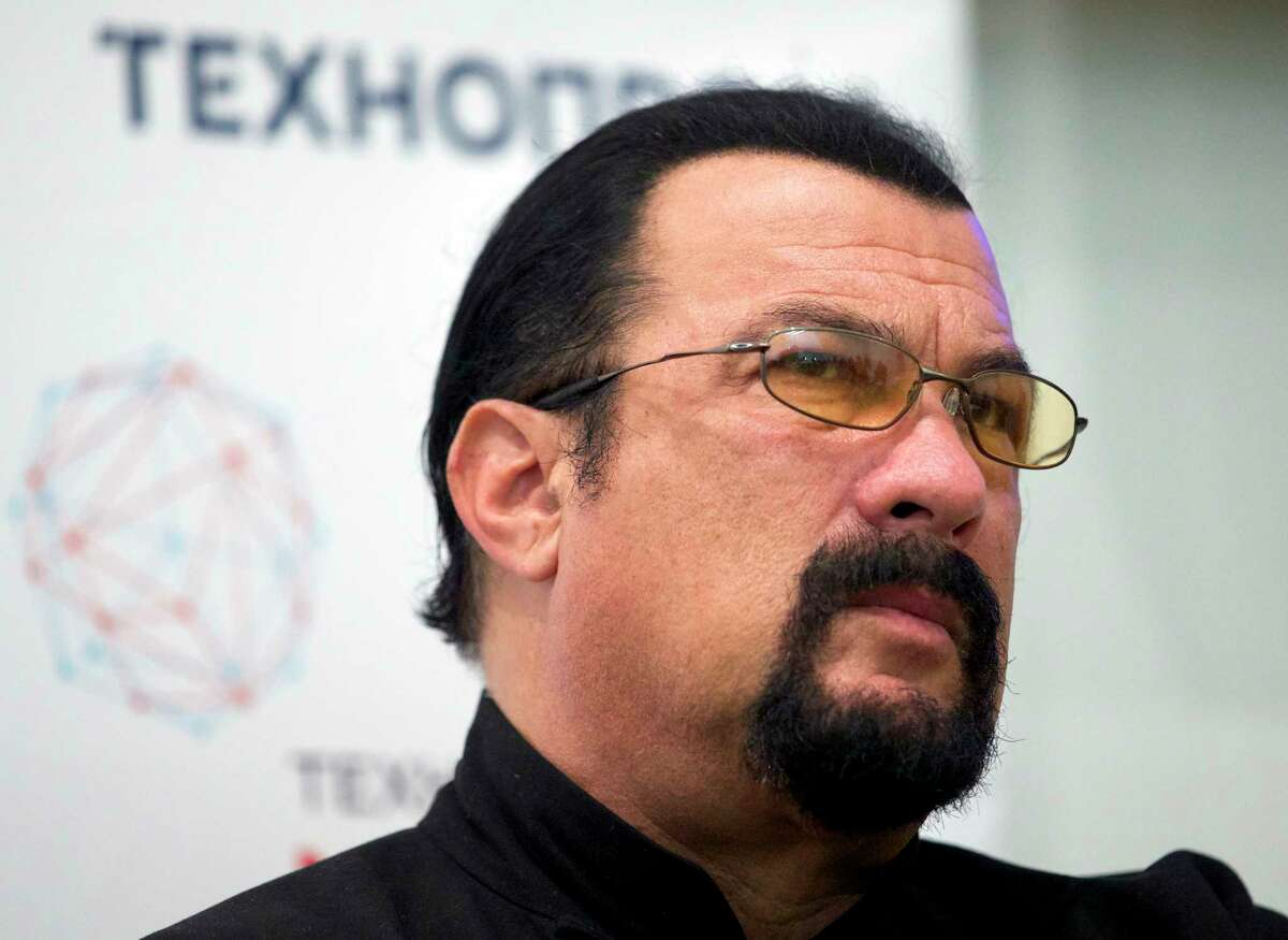 FILE - In this Sept. 22, 2015, file photo, actor Steven Seagal speaks at a news conference, while attending an opening ceremony for a research and development center in Moscow, Russia. Jenny McCarthy said on her Sirius XM show Nov. 9, 2017, that Seagal sexually harassed her during an audition in 1995. A Seagal spokesman has denied the McCarthyÂ?'s accusations to The Daily Beast. (AP Photo/Ivan Sekretarev, File)