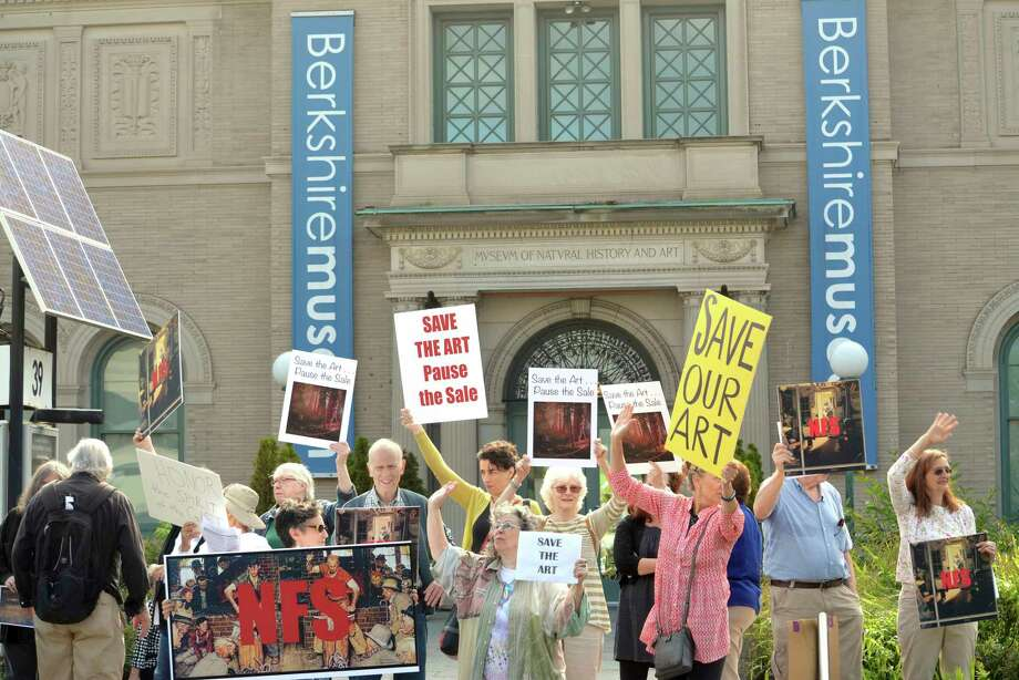 About 40 people opposed to the selling of The Berkshire Museum's art to fund an expansion and endowment, protest in front of museum in Pittsfield, Mass. on Saturday, Aug. 12, 2017. Some of the works on the auction block include original paintings by Norman Rockwell, a resident of The Berkshires, who gifted the art to the museum decades ago.   (Gillian Jones/The Berkshire Eagle via AP) Photo: Gillian Jones / The Berkshire Eagle