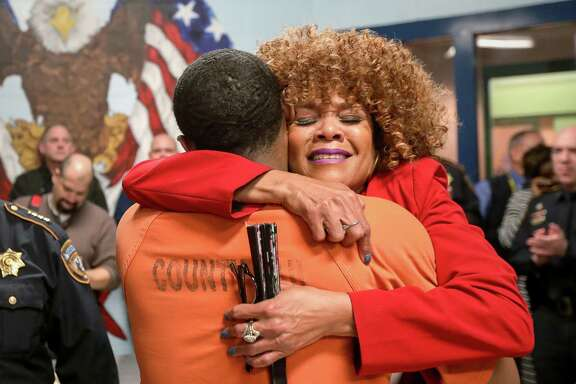 Raunda Lindsey, who works in the reentry services program at the Harris County Jail, hugs David Ford, III, a United States Army veteran, during a dedication ceremony for a veterans wing, Friday, Nov. 10, 2017, in Houston.  ( Jon Shapley / Houston Chronicle )