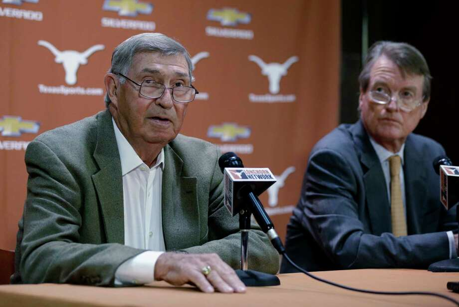 FILE - In this Oct. 1, 2013, file photo, Texas athletic director DeLoss Dodds, left, with Texas president Bill Powers, right, formally announces his retirement during a news conference, in Austin, Texas. Dodds, Powers and former football coach Mack Brown all are scheduled to be questioned under oath next week in a sex and race discrimination lawsuit filed by former women's track coach Bev Kearney, who was forced out after the school learned she had a romantic relationship with one of her athletes a decade earlier. (AP Photo/Eric Gay, File) Photo: Eric Gay, STF / Copyright 2017 The Associated Press. All rights reserved.