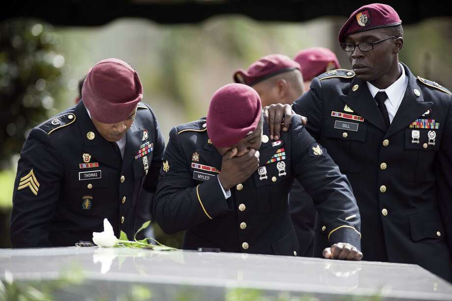 Members of the 3rd Special Forces Group, 2nd battalion say goodbye at the burial service for Army Sgt. La David Johnson, one of four U.S. soldiers killed in an ambush last month in Niger. Photo: GASTON DE CARDENAS, Contributor / AFP or licensors