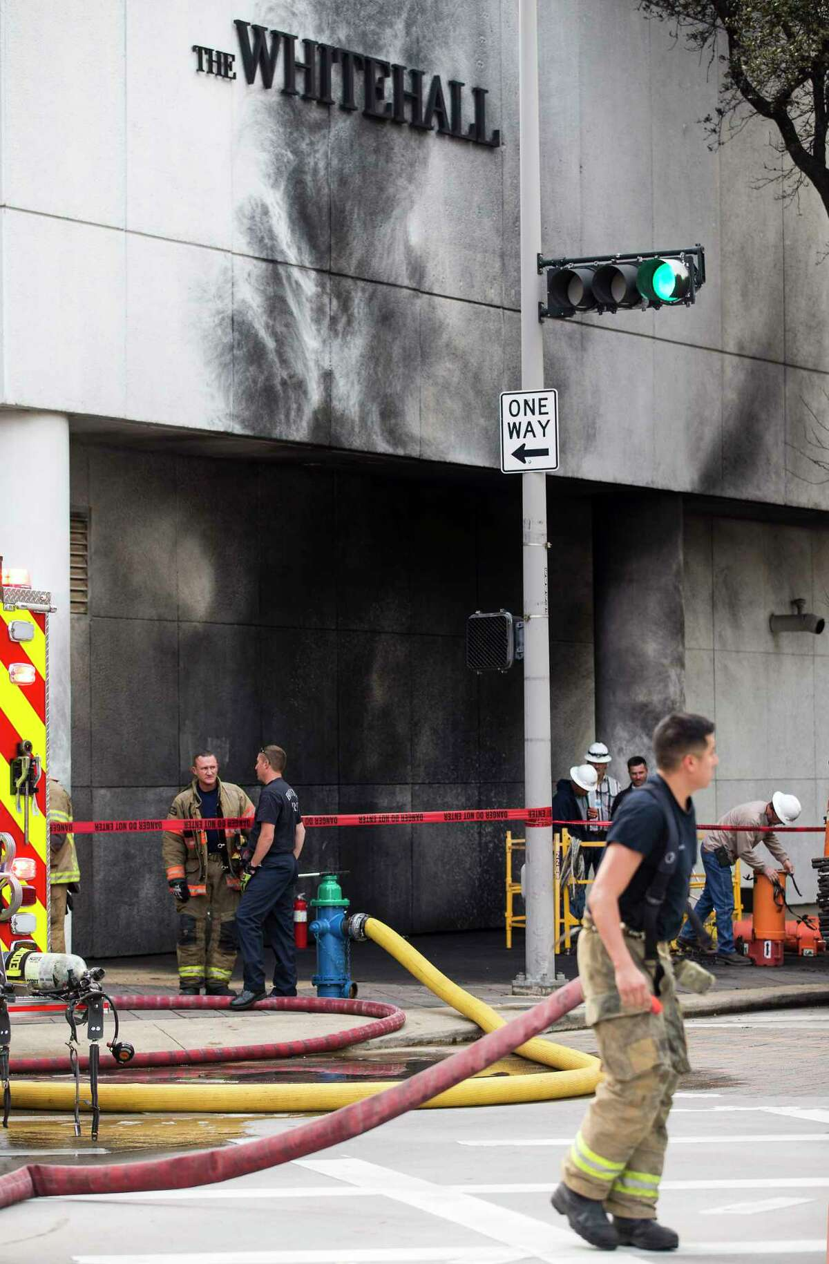 Houston firefighters work the scene of an explosion Friday at The Whitehall Hotel downtown. One person was transported to a hospital with life-threatening injuries, Deputy Chief Blake White said.