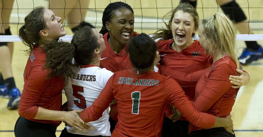 The Woodlands celebrates after defeating Klein 28-26 during the second set of a Region II-6A semifinal volleyball match at Johnson Coliseum, Friday, Nov. 10, 2017, in Huntsville. The Woodlands defeated Klein in straight sets. Photo: Jason Fochtman/Houston Chronicle