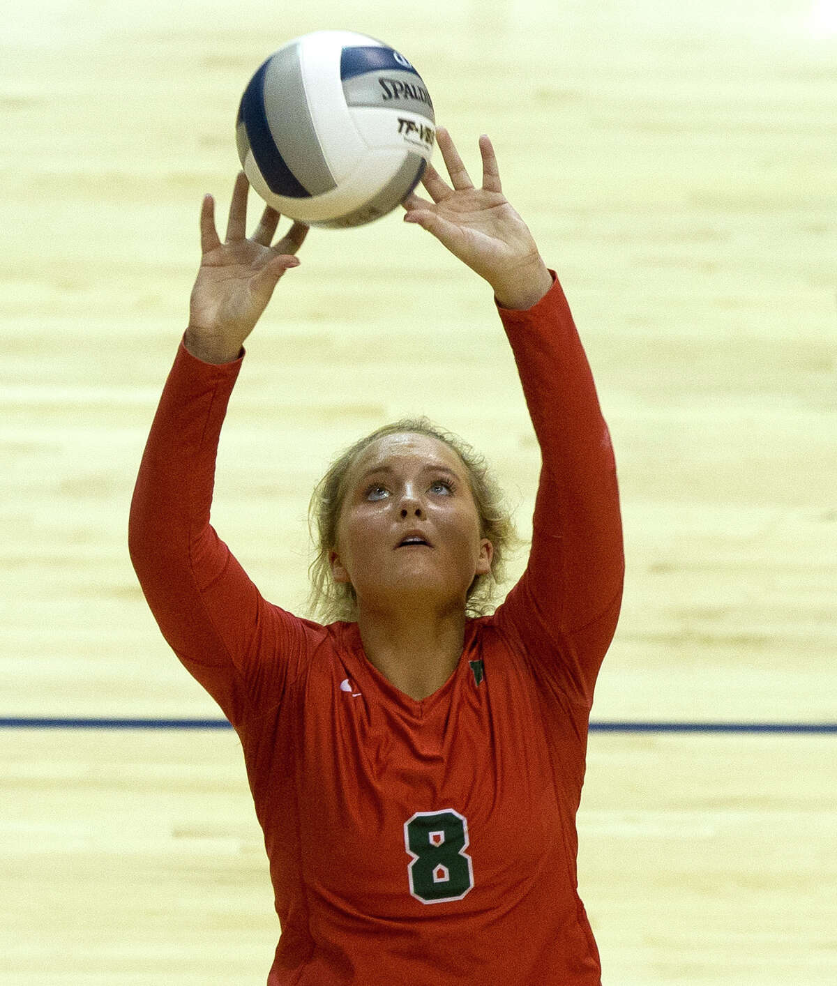 The Woodlands Sophie Walls (8) sets the ball during the second set of a Region II-6A semifinal volleyball match at Johnson Coliseum, Friday, Nov. 10, 2017, in Huntsville.
