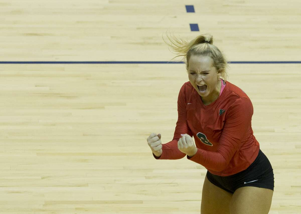 The Woodlands setter Sophie Walls (8) celebrates a point during the second set of a Region II-6A semifinal volleyball match at Johnson Coliseum, Friday, Nov. 10, 2017, in Huntsville.