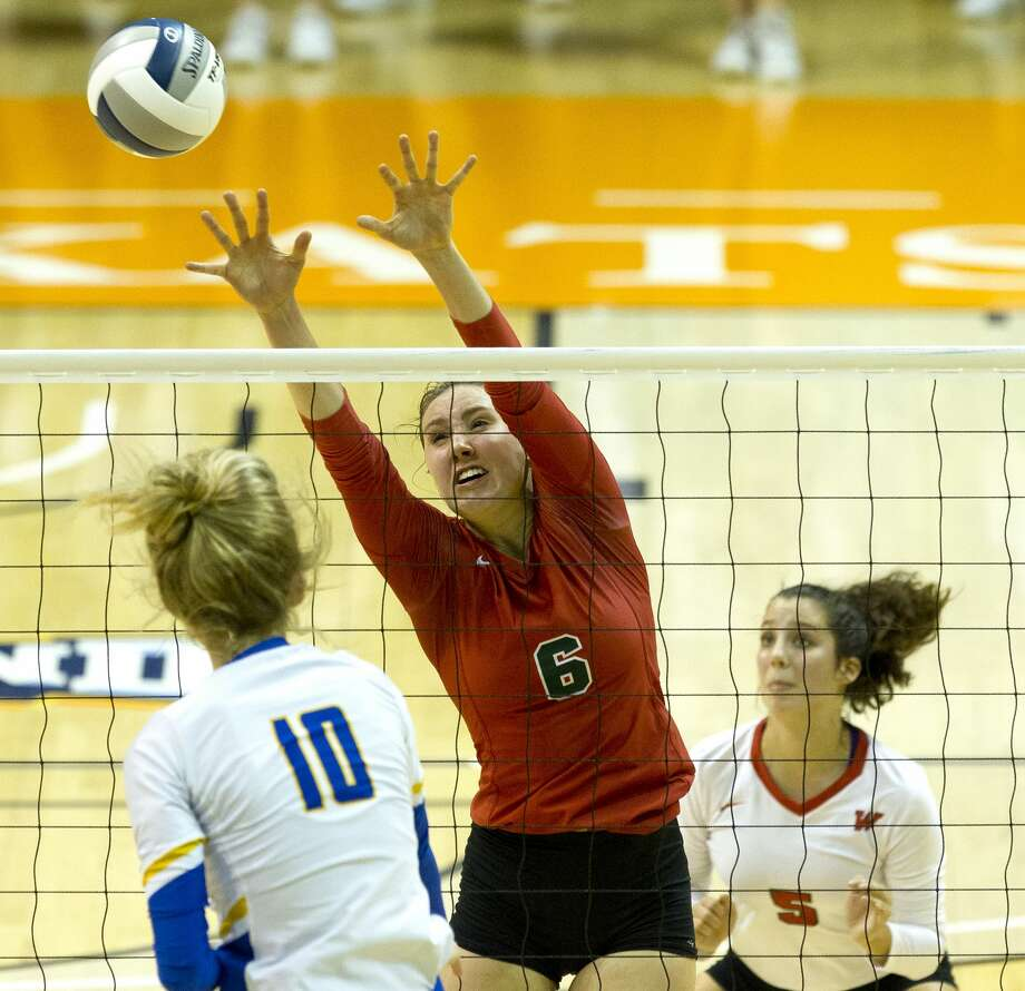 The Woodlands outside hitter Courtney Heiser (6) pressures a shot by Klein middle hitter Ashlen Jennings (10) during the second set of a Region II-6A semifinal volleyball match at Johnson Coliseum, Friday, Nov. 10, 2017, in Huntsville. Photo: Jason Fochtman/Houston Chronicle
