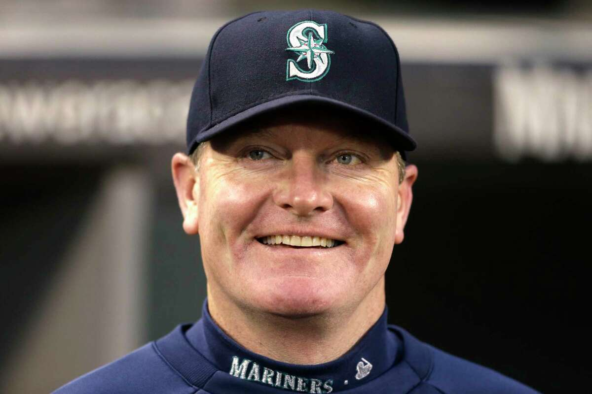 FILE - In this Sept. 25, 2013, file photo, then-Seattle Mariners manager Eric Wedge smiles before a baseball game against the Kansas City Royals, in Seattle. Former Cleveland and Seattle manager Eric Wedge has become the second person to interview with the New York Yankees for their dugout opening. He follows Yankees bench coach Rob Thomson, who interviewed Wednesday, Nov. 10, 2017. (AP Photo/Elaine Thompson, File) ORG XMIT: NY189