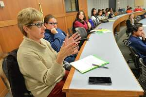 Suzanne Bartek asks a question about the degrees offered through the Norwalk Early Learning Academy during a program at NCC in Norwalk on Thursday for interested students and parents, as her daughter Madison will be a freshman at Norwalk High School next year.