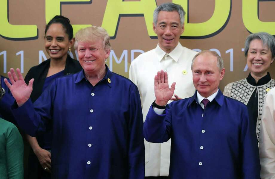 President Donald Trump and Russia's Vladimir Putin join other leaders before the APEC summit. Photo: MIKHAIL KLIMENTYEV, Contributor / AFP