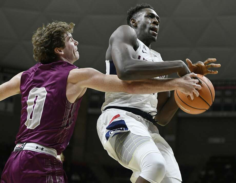 Colgate's SeanO'Brien, left, strips the ball from Connecticut's Mamadou Diarra, right, during the first half of an NCAA college basketball game, Friday, Nov. 10, 2017, in Storrs, Conn. (AP Photo/Jessica Hill) Photo: Jessica Hill/Associated Press