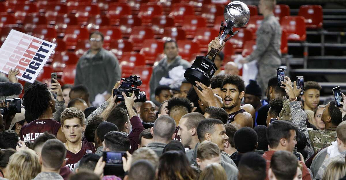 Aggies' Tyler Davis displays the trophy after a college basketball match of the Armed Forces Classic between Texas A&M Aggies and West Virginia Mountaineers on the US Air Base in Ramstein, Germany, Saturday, Nov. 11, 2017. (AP Photo/Michael Probst)