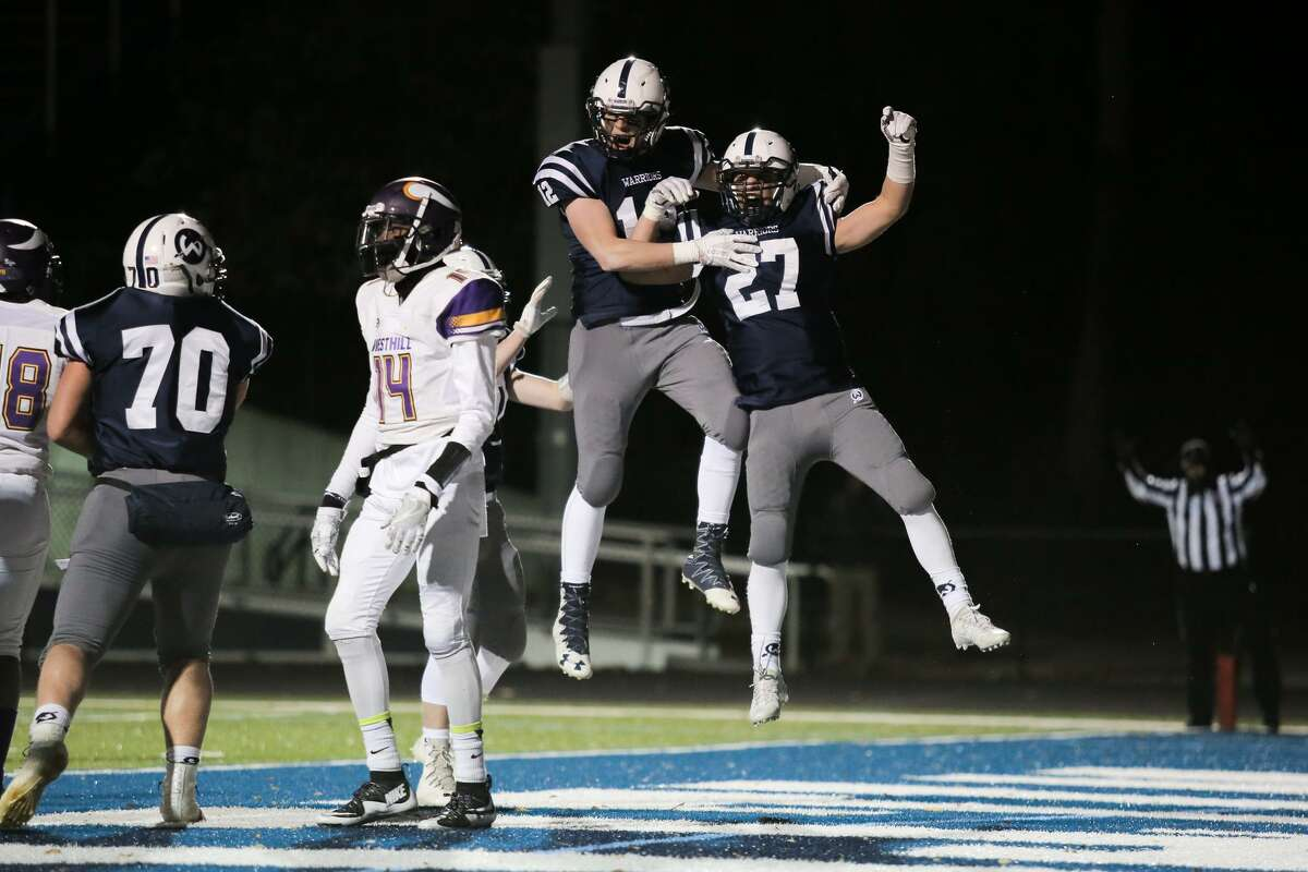 Kyle Shifrin and Harvey Alexander celebrate a touchdown during the Warriors victory over Westhill in Wilton, Conn. on Friday, November 10, 2017.