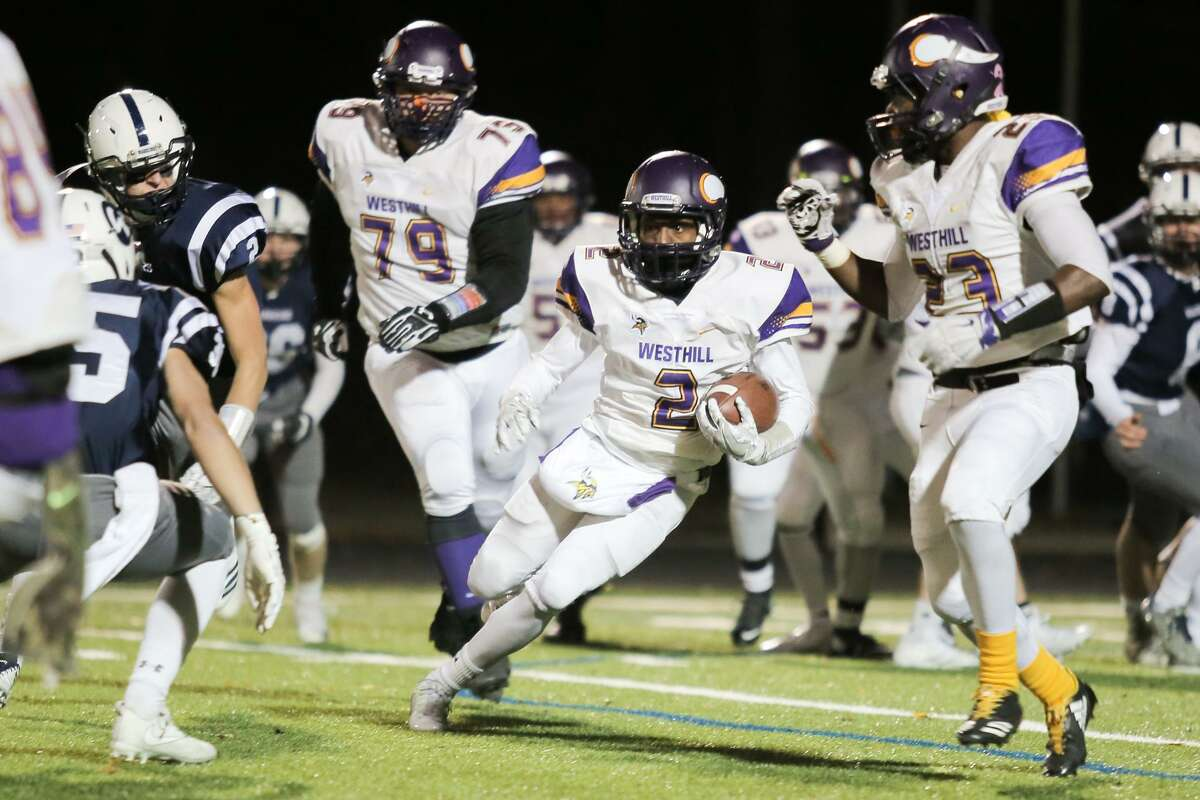 Westhill's Noodles Metayer runs the ball through Wilton defense during the Warriors victory over Westhill in Wilton, Conn. on Friday, November 10, 2017.