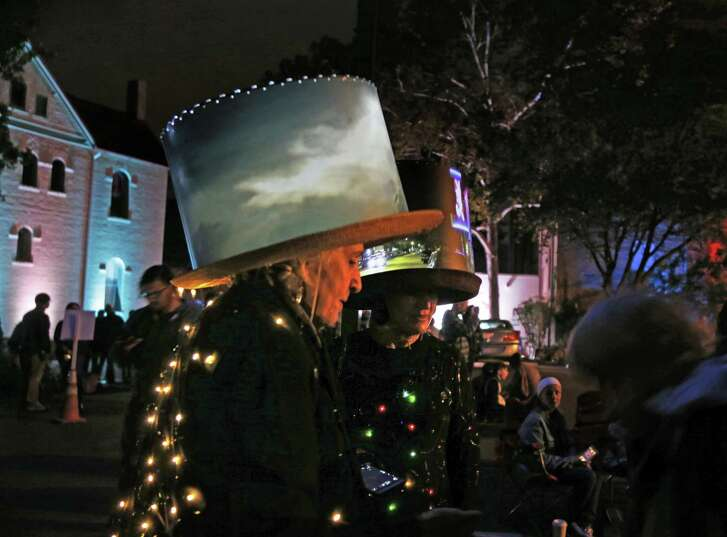 Illuminated clothing — such as the hats worn by artist Joan Frederick and friend Irene Dietrich last year — is a hallmark of Luminaria. Those who post photos of themselves to Instagram will be eligible for the Light Up the Night contest.