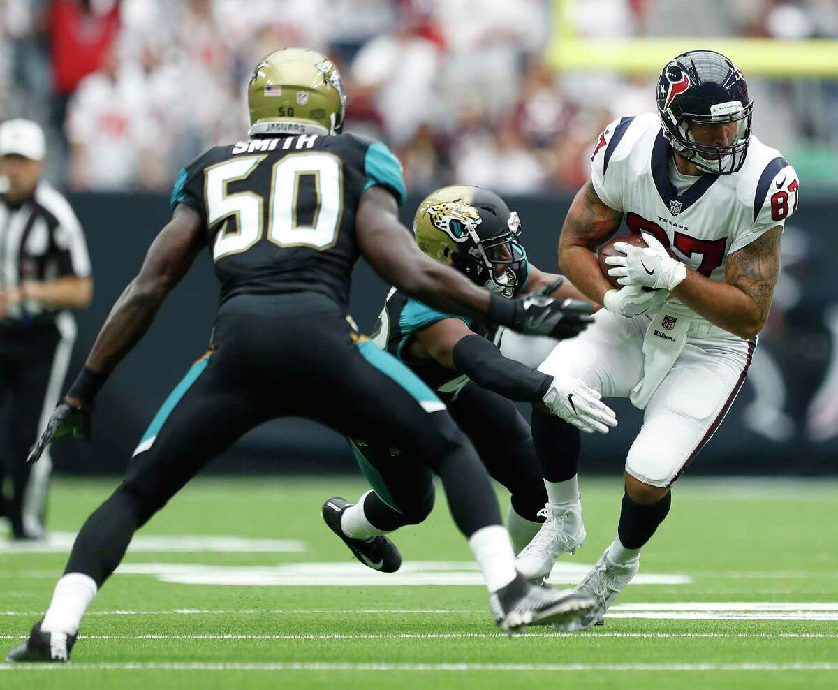 Texans tight end C.J. Fiedorowicz, right, has seen scant action this year after receiving a concussion on this pass reception against the Jaguars in the season opener at NRG Stadium. He got off injured reserve Friday.