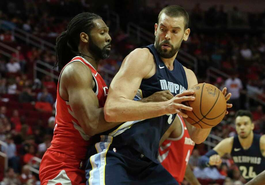 Rockets center Nene, left, gets physical with Grizzlies center Marc Gasol during their Oct. 23 matchup. The Rockets see today's rematch at Toyota Center as critical in the long run. Photo: Yi-Chin Lee, Houston Chronicle / © 2017  Houston Chronicle