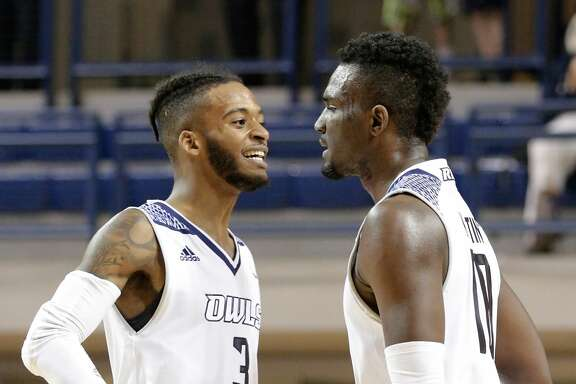 Rice Owls guard Ako Adams (3) and forward Robert Martin (10) celebrate Martin's score in the first half of their game against Eastern Kentucky, Nov. 10, 2017, in Houston, TX. (Michael Wyke / For the  Chronicle).