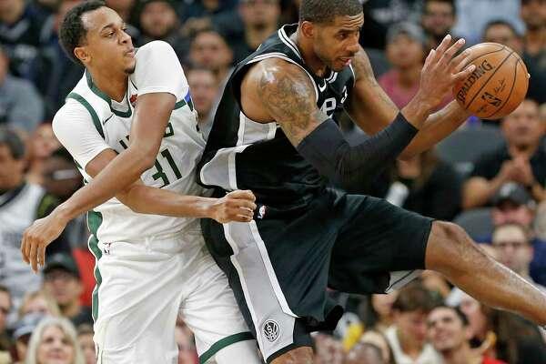 Milwaukee BucksÕ John Henson and San Antonio Spurs' LaMarcus Aldridge grab for a rebound during first half action Friday Nov. 10, 2017 at the AT&T Center.
