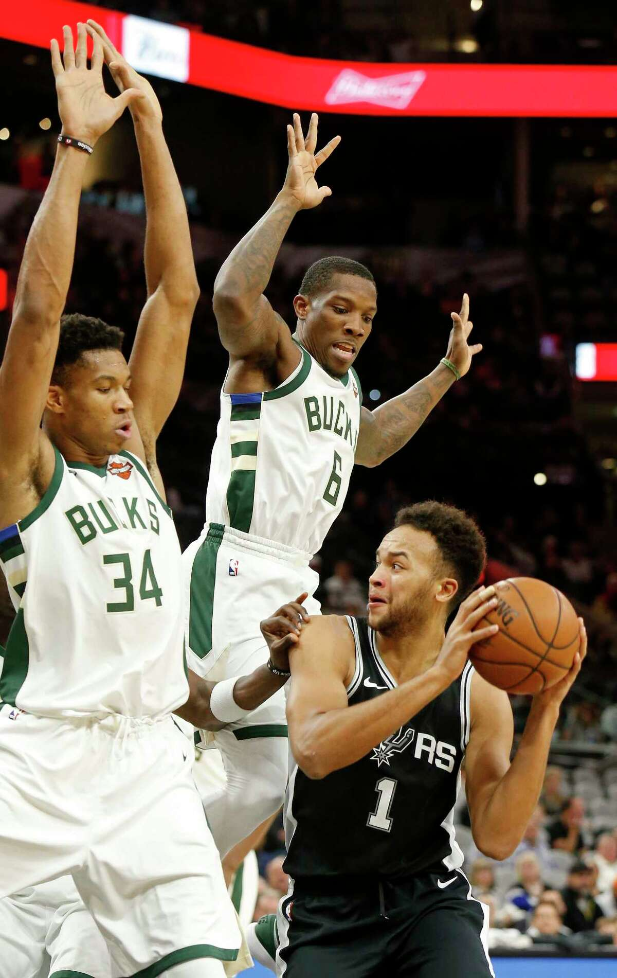 San Antonio Spurs Kyle Anderson looks for room around Milwaukee Bucks Giannis Antetokounmpo (left) and Eric Bledsoe during first half action Friday Nov. 10, 2017 at the AT&T Center.