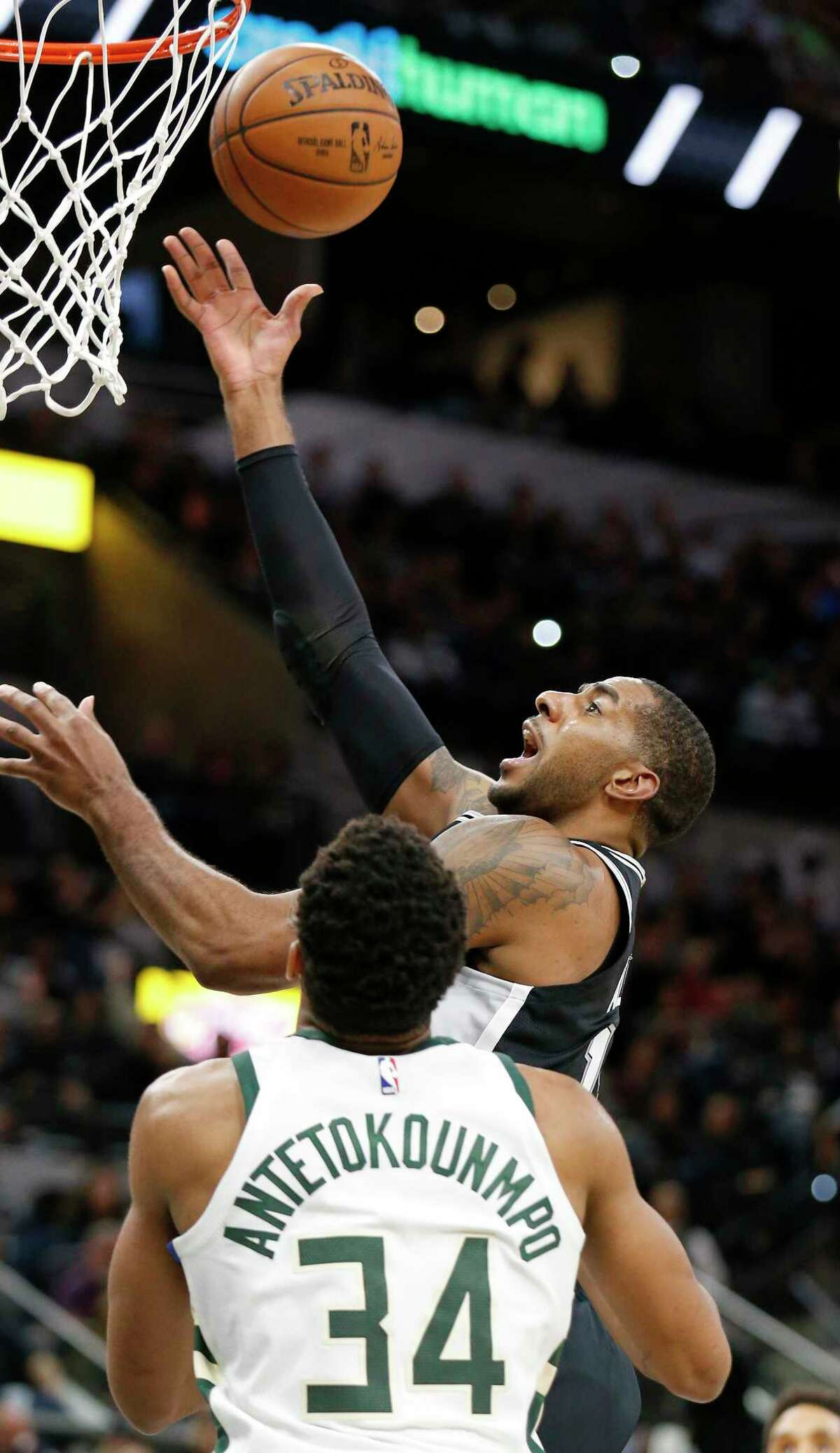 San Antonio Spurs' LaMarcus Aldridge shoots around Milwaukee Bucks Giannis Antetokounmpo during first half action Friday Nov. 10, 2017 at the AT&T Center.