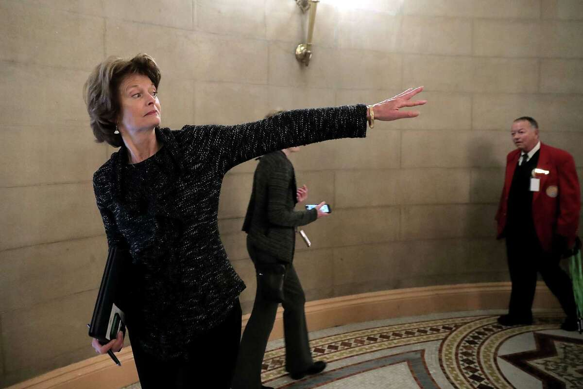 WASHINGTON, DC - NOVEMBER 09: Sen. Lisa Murkowski (R-AK) waves to a group of journalists before heading into a meeting at the U.S. Capitol November 9, 2017 in Washington, DC. Senate Republicans are meeting behind closed doors to get their first look at their proposed tax cut and reform legislation. (Photo by Chip Somodevilla/Getty Images)