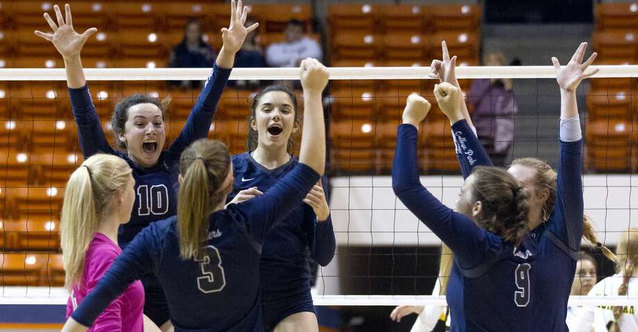 College Park celebrate after defeating Klein Oak in straight set during a Region II-6A semifinal match at Johnson Coliseum, Friday, Nov. 10, 2017, in Huntsville. Photo: Jason Fochtman/Houston Chronicle